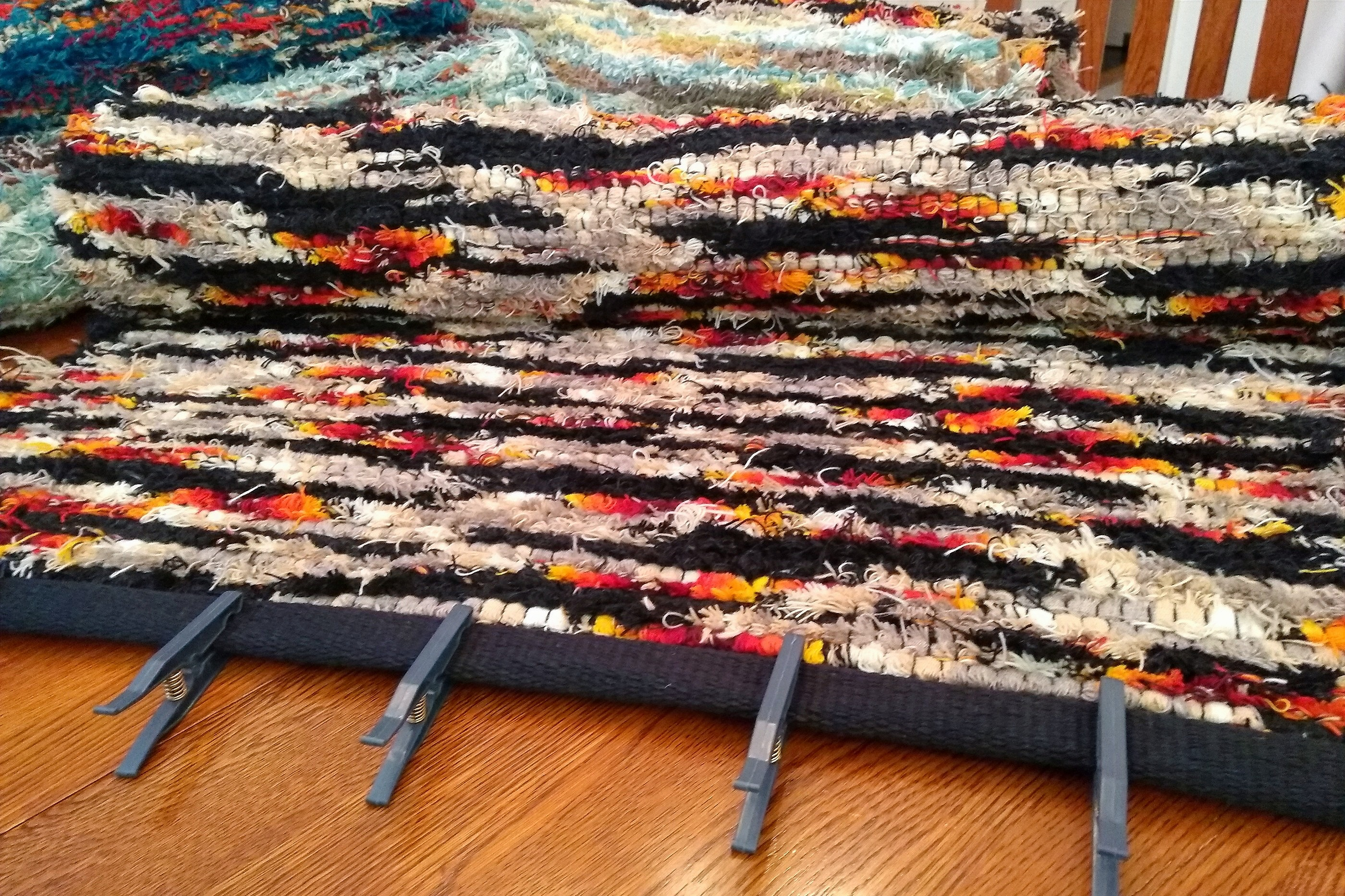 Preparing a rug for hemming on my sewing machine.