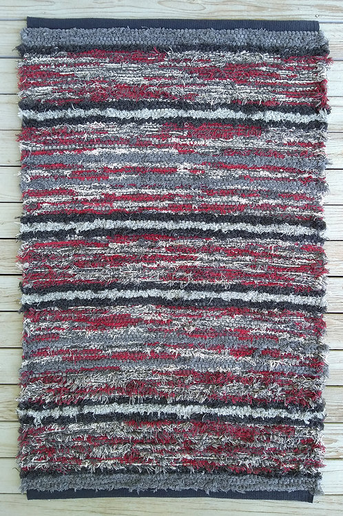 Handwoven rug with gray and maroon stripes