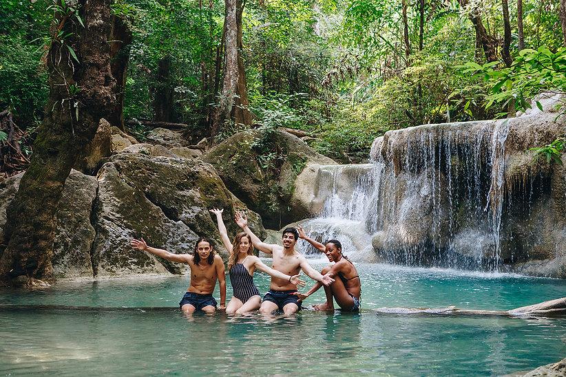 group-of-diverse-friends-enjoying-the-waterfall-PYQ6ME3.jpg