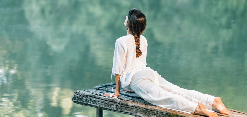 yoga-by-the-lake-young-woman-in-cobra-po