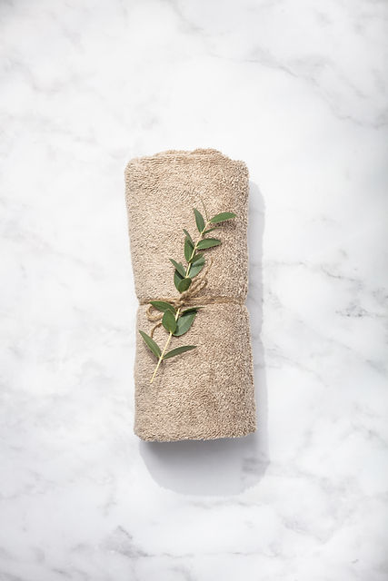 green-branch-and-spa-towel-on-white-marb