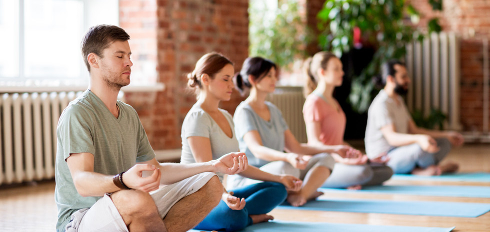 group-of-people-making-yoga-exercises-at