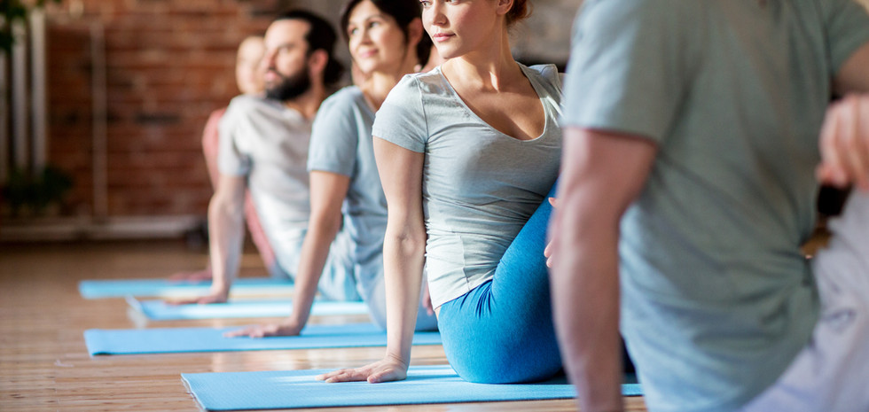 group-of-people-doing-yoga-exercises-at-