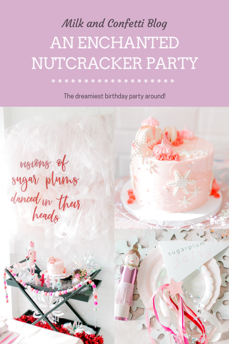 Sugar plum birthday party with hanging paper and clear snowflakes and tulle with a snowflake cake at a nutcracker birthday party.