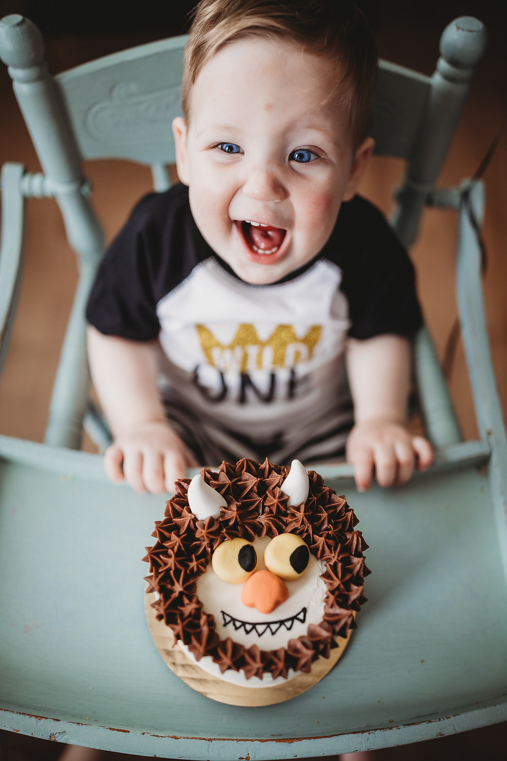 baby at first birthday party with cake