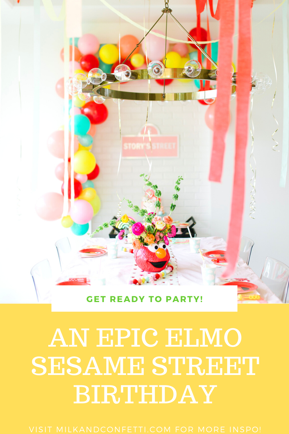 A Sesame Street Elmo Second birthday party with balloons, streamers cake and flowers!
