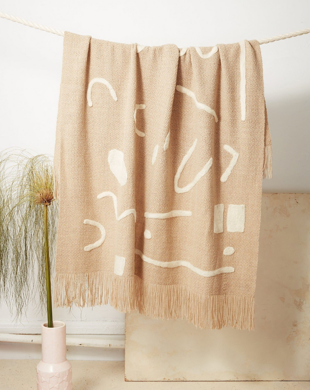 Sustainable cream and beige blanket with abstract print.
