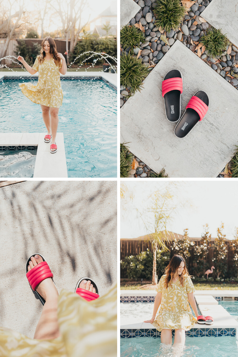 A girl happily standing by the pool in her summer dress and pink sandals.
