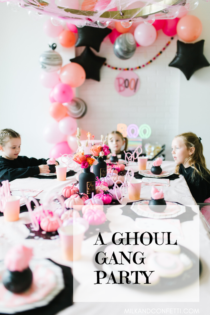 A ghoul gang Halloween party with Halloween decor