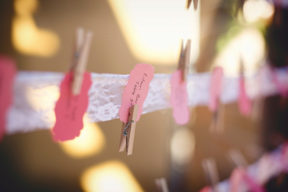 A string of lace displaying guests names at a wedding.