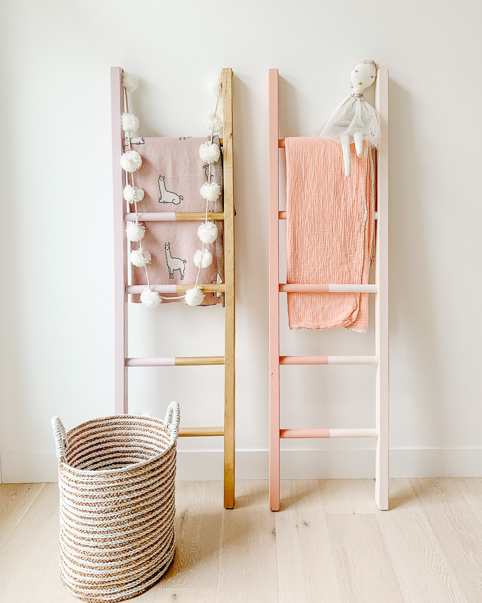 Two painted blanket ladders against a wall.