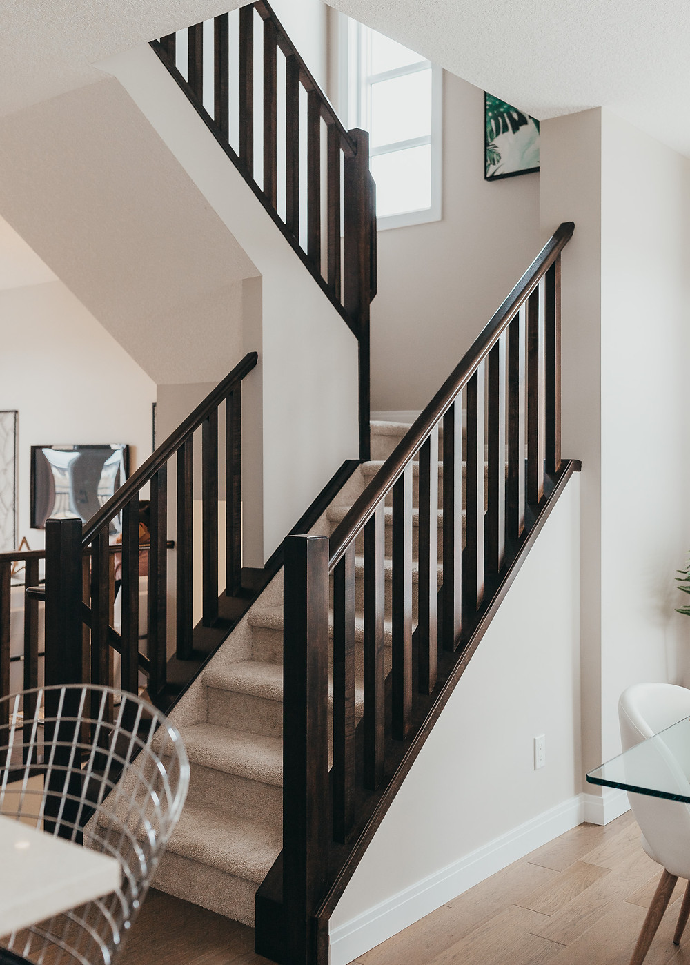 A dark wooden staircase in a new home.
