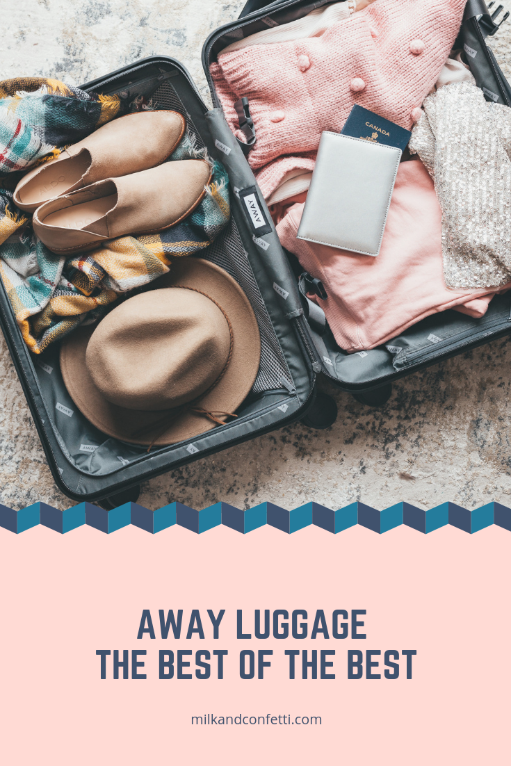 An open suitcase laying on the floor filled with some beautiful clothing and a passport.