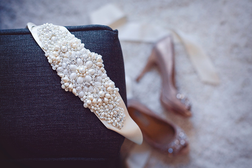 A Lazaro satin wedding belt embellished with pearls and crystals.