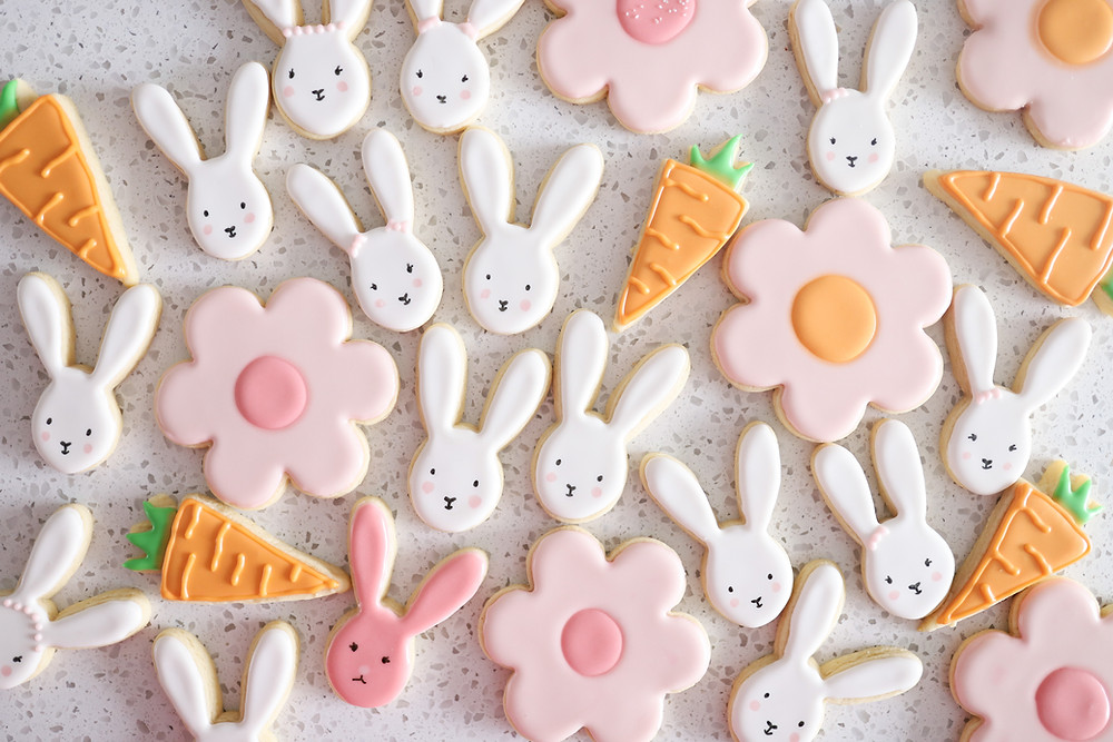 Sugar cookies decorated as carrots, bunnies and flowers for a birthday celebration.