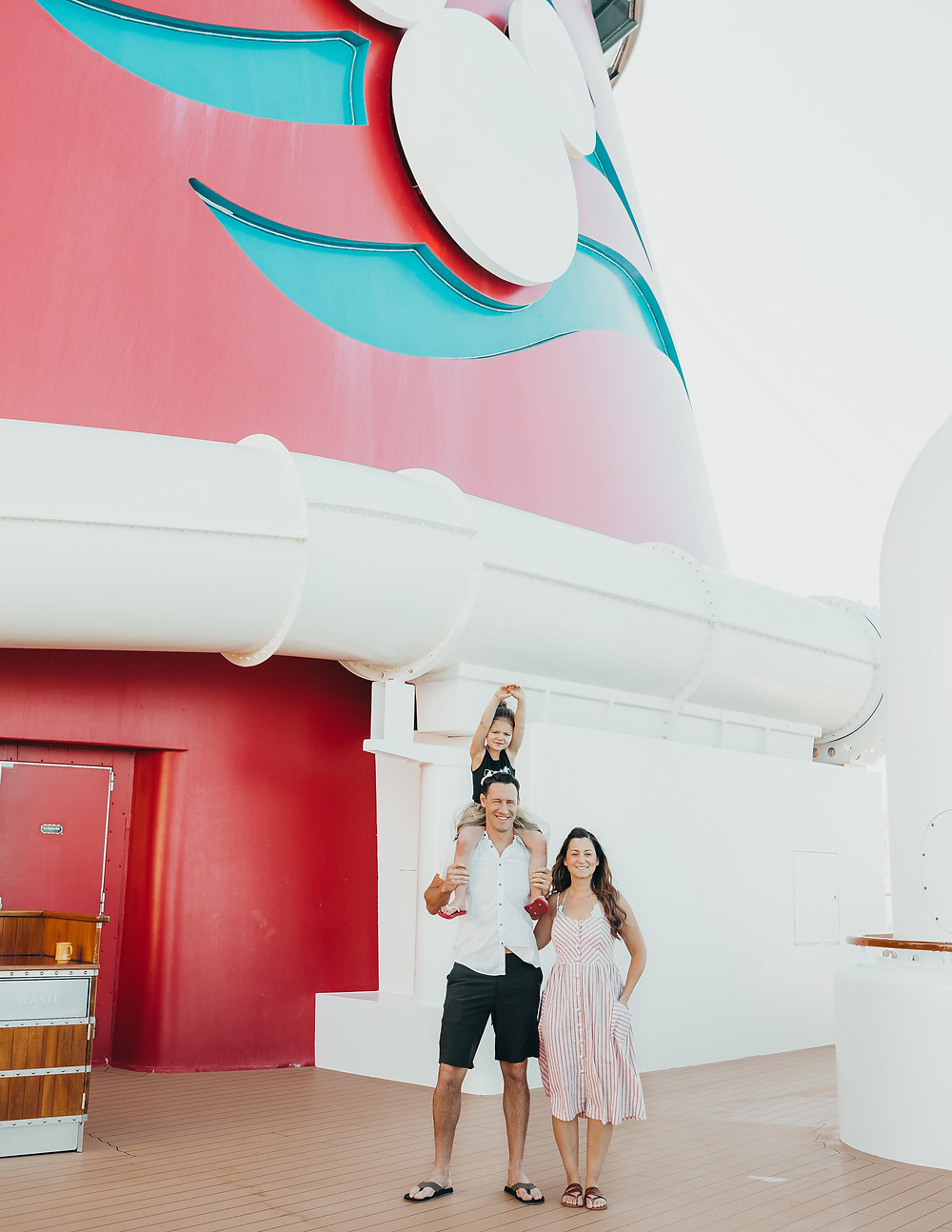 A family standing together on a Disney Cruise ship.