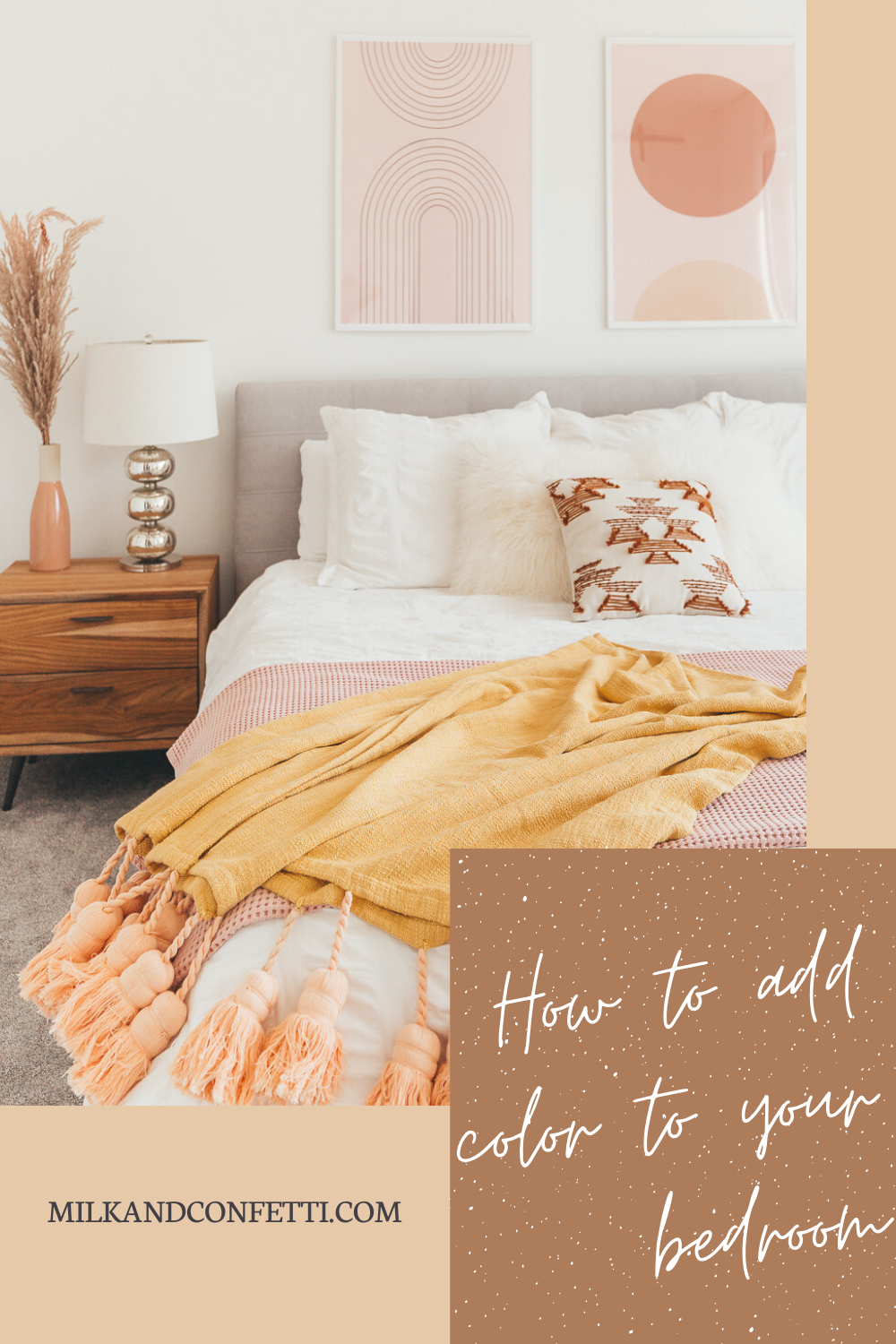 A boho master bedroom with blush and mustard accents on a mid century bed frame next to some pampas grasses.