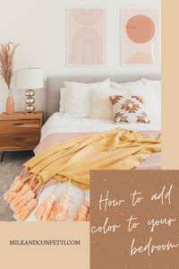 A master bedroom with blush accents.