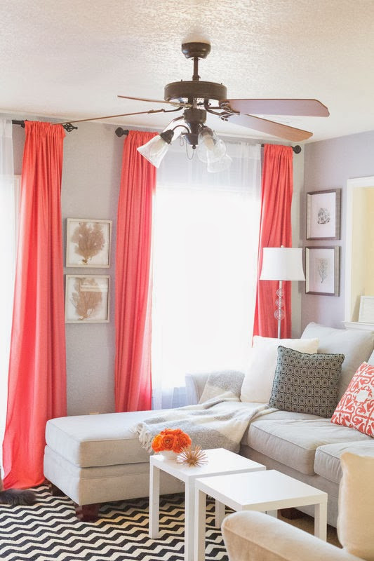 Coral curtains hanging in a living room