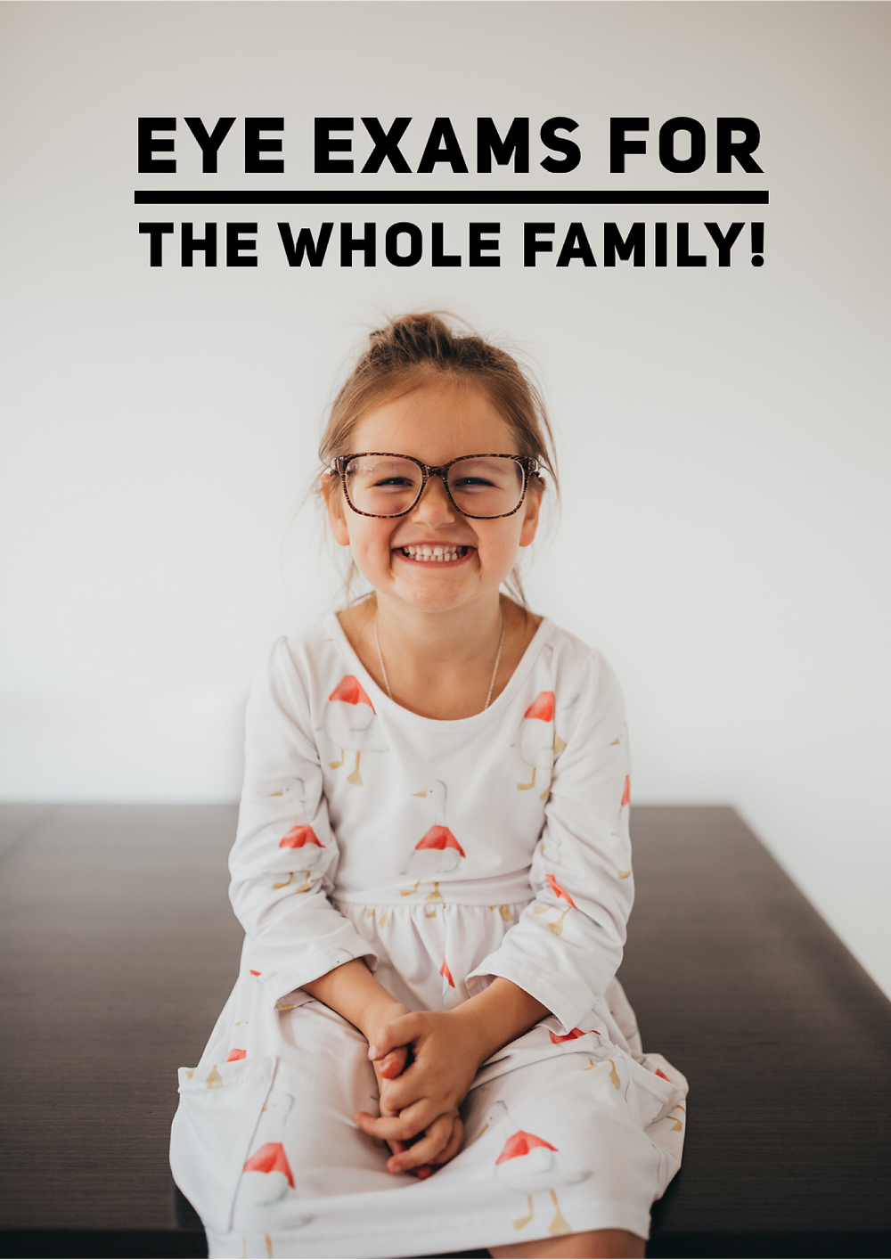 Little girl wearing big glasses smiling