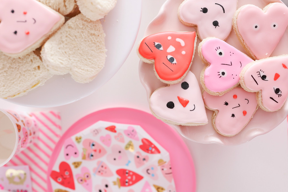 Heart cookies decorated for a Valentine's Day party.