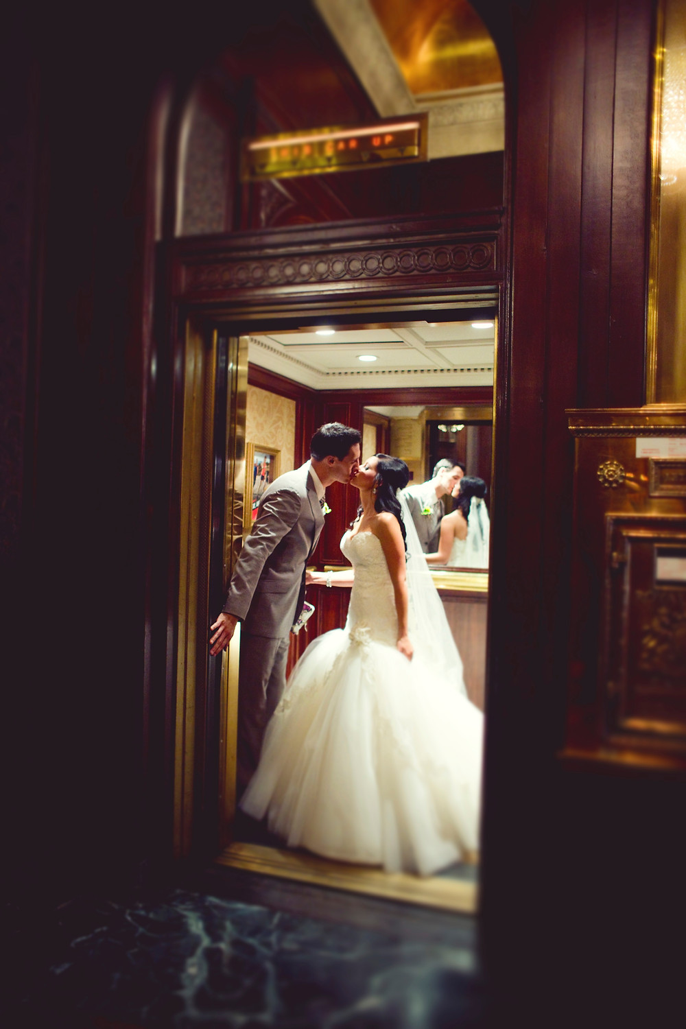 A bride and groom standing in an elevator.