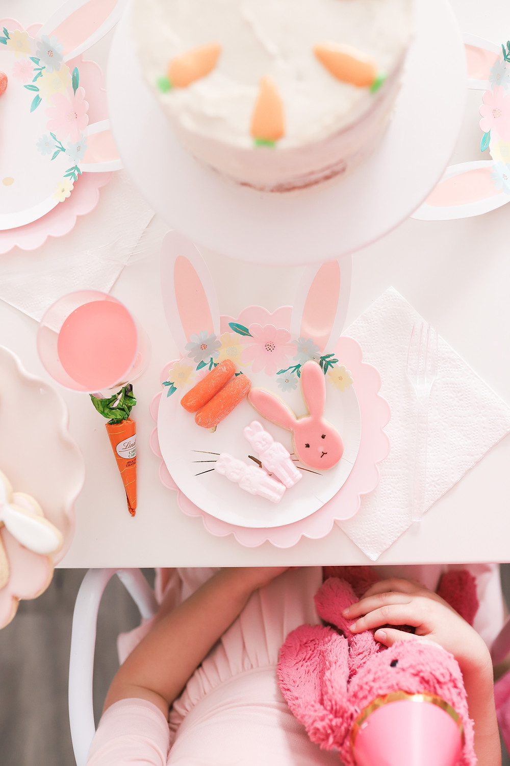 A plate of treats Easter at a bunny birthday on a floral bunny paper plate