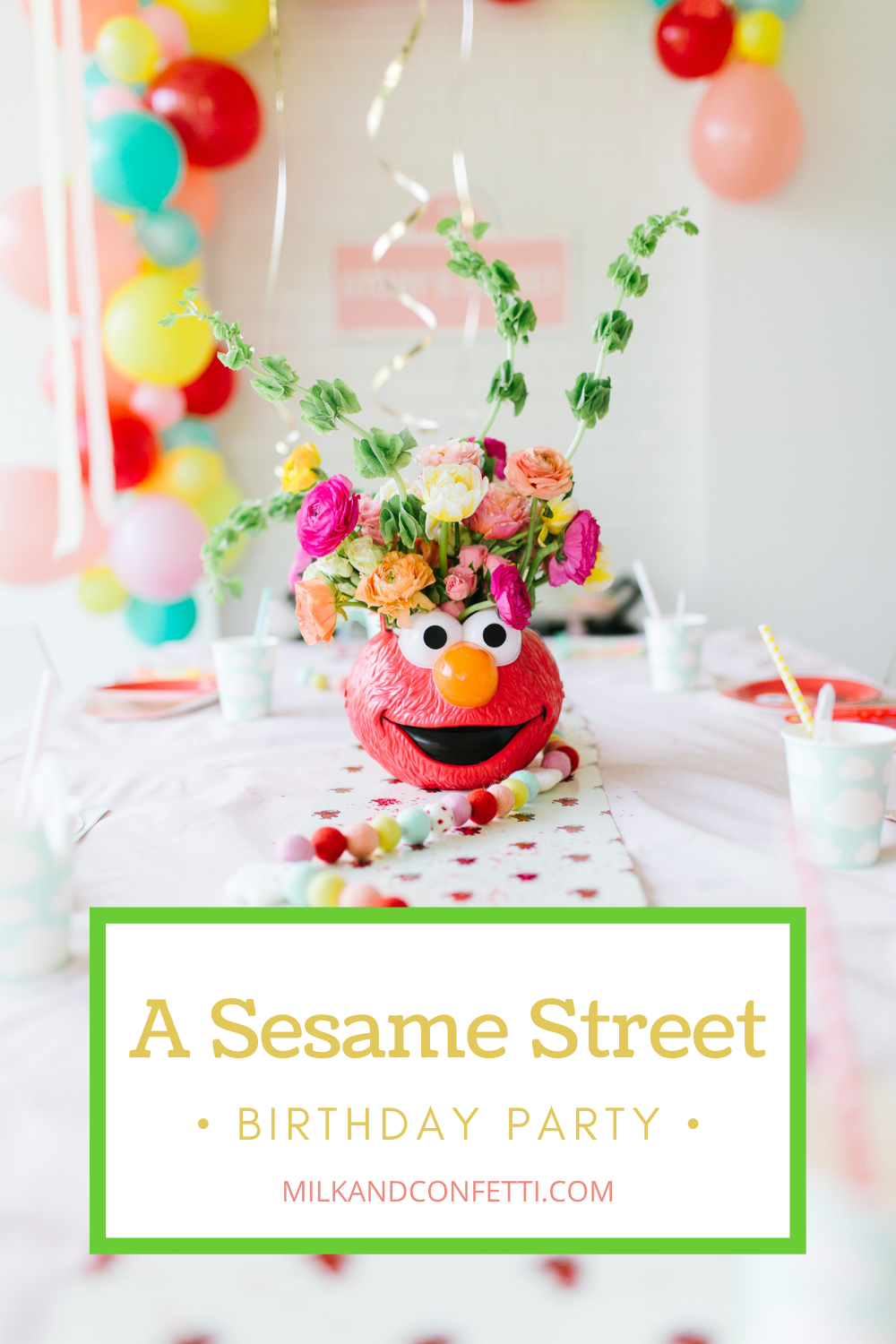 A Sesame Street Elmo Second birthday with balloons, streamers cake and flowers!