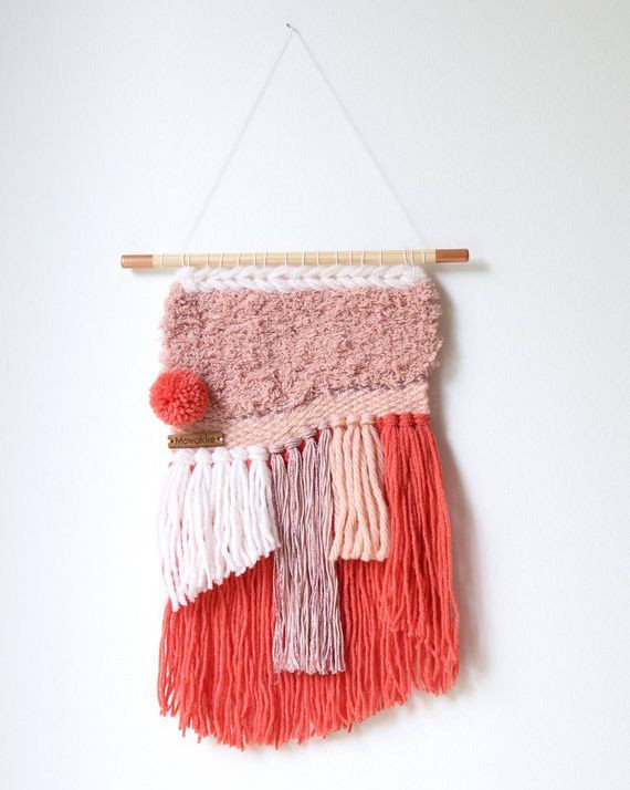 Coral and blush woven wall hanging