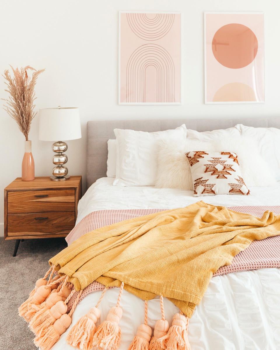 A blush and mustard boho bedroom.