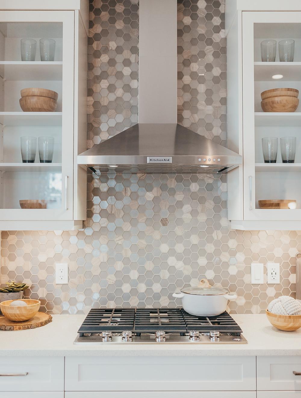 Hexagon tilde backsplash in a modern white kitchen