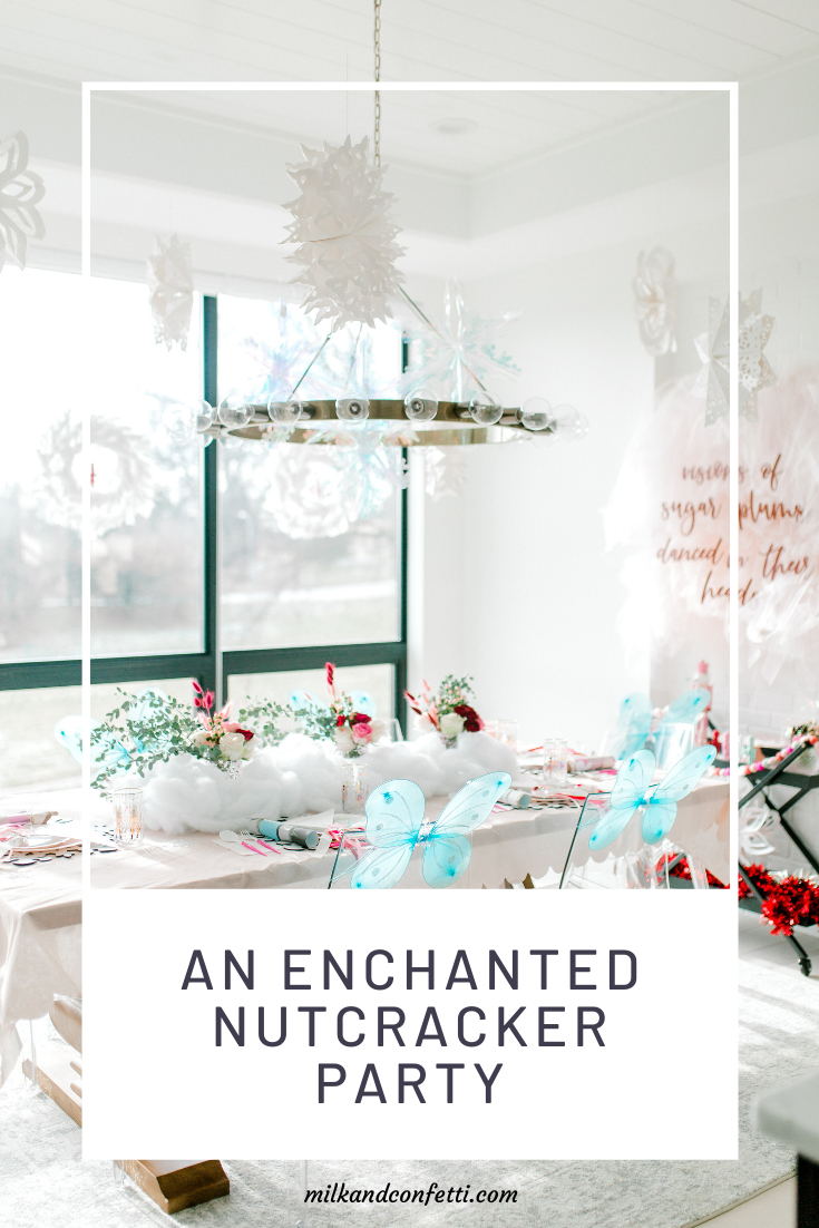 An enchanted Nutcracker Birthday Party with floral and cotton decor, glitter snowflakes and blue fairy wings.
