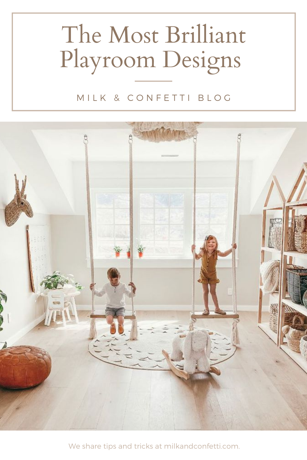 A neutral scandinavian childrens playroom idea with rope style swings, white table and chairs and simple shelving with storage baskets