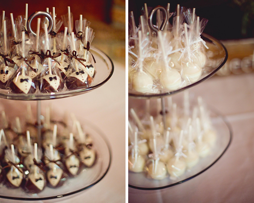Bride and groom cake pops at a wedding.