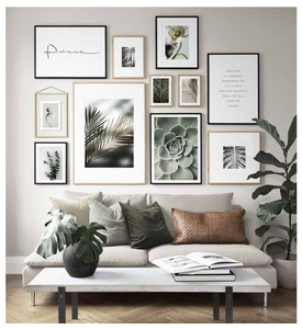 A peaceful living room decorated with neutral tones and earthy photos.