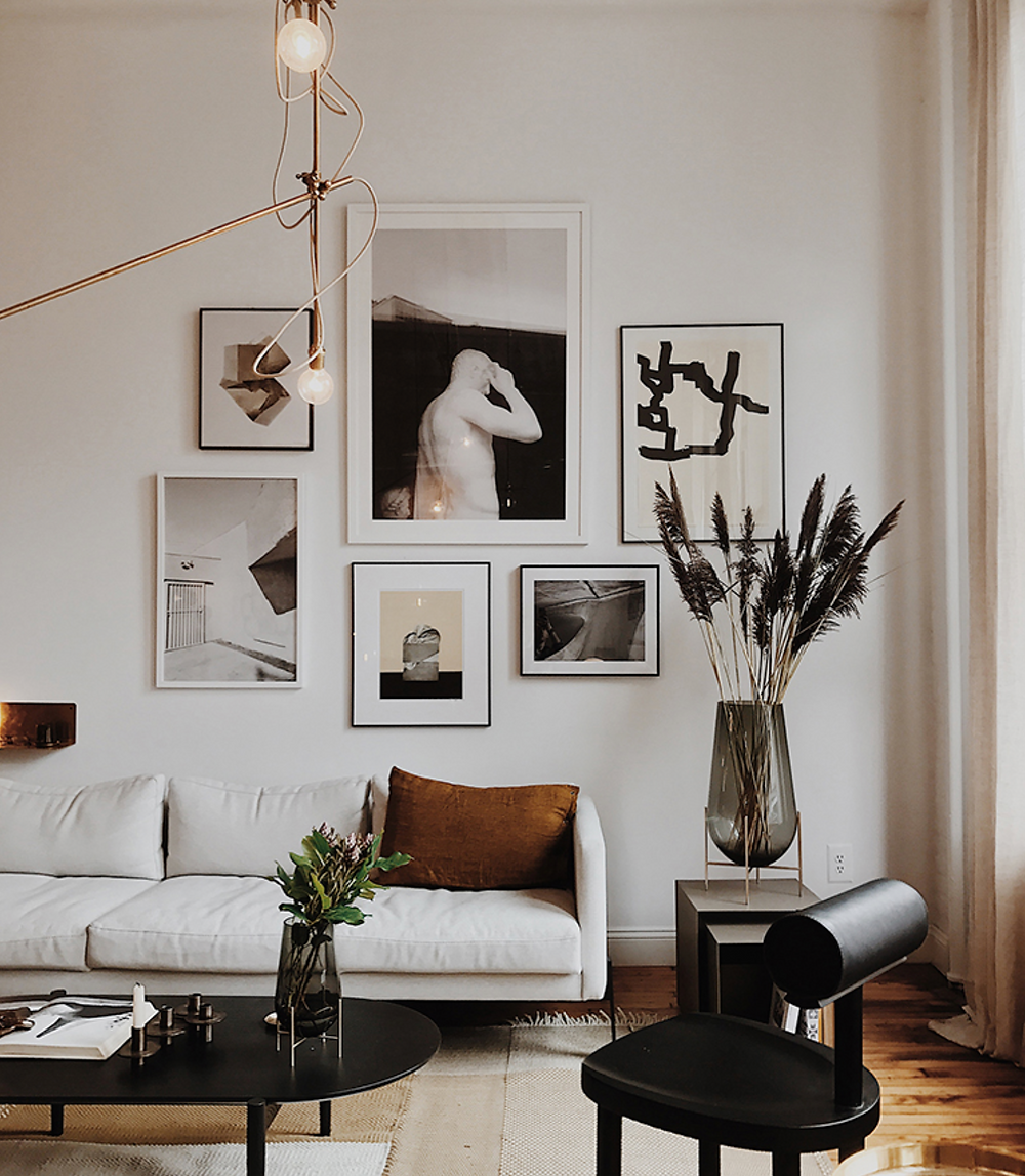 A modern but cozy living room with a white sofa and impactful gallery wall.