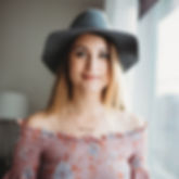 Girl with hat on wearing a pink dress