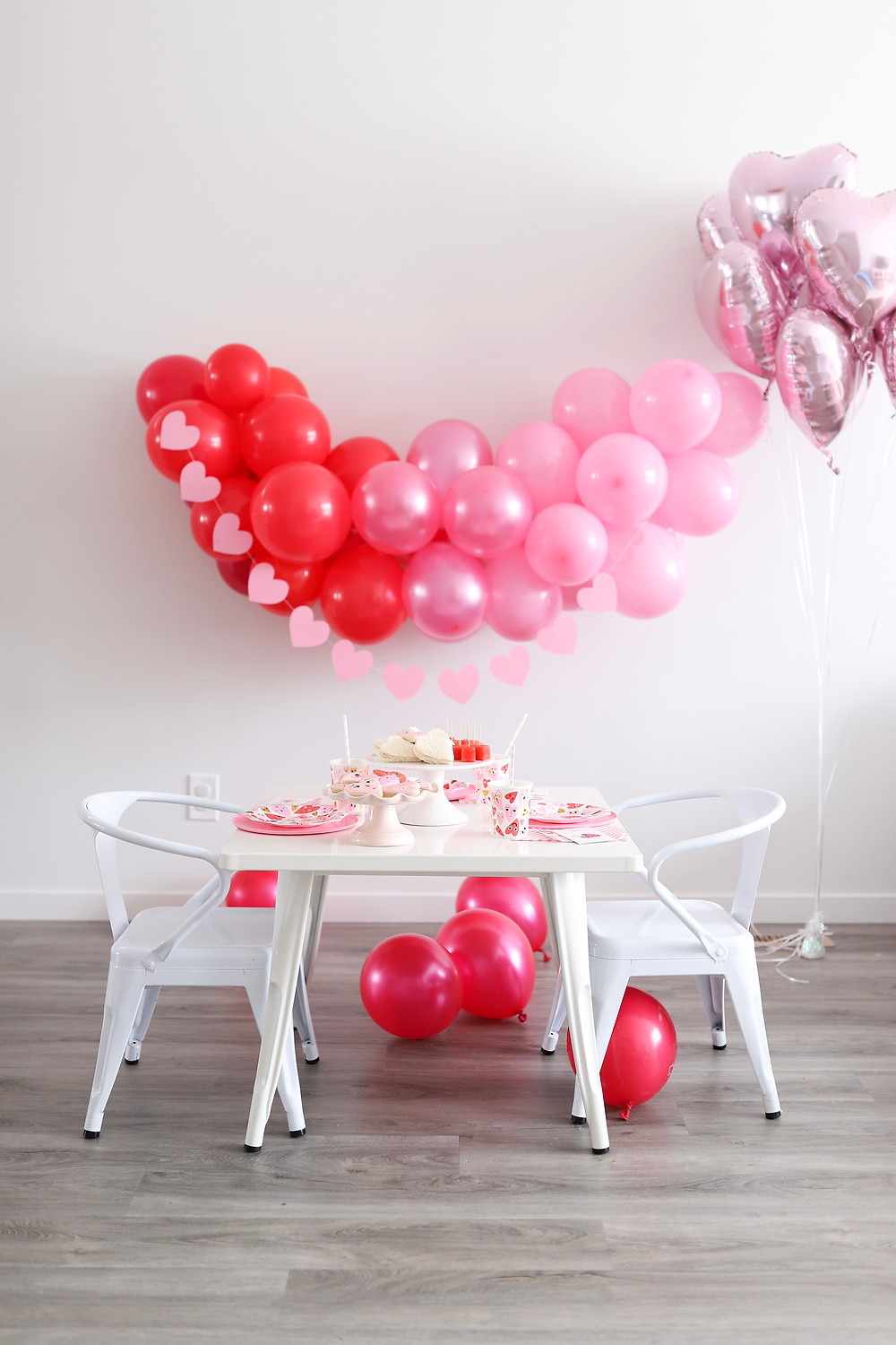 A room set for a little girls Valentine's Day party.