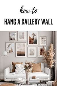 A beautiful living room with a gallery wall hanging above the sofa.