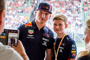 meet a f1 driver max verstappen at the redbull racing paddock club