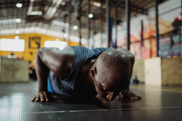 A man at the end of a push-up, ready to start the next rep