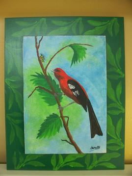 Red bird on wood