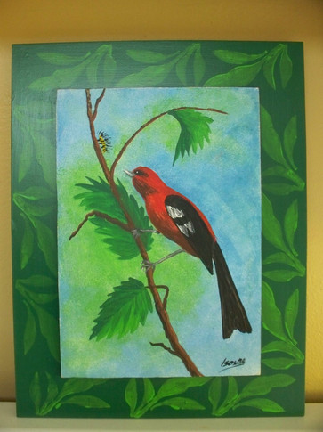 Red bird on wood