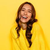 smile-makers-woman-yellow.jpg