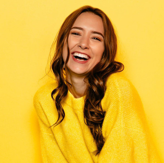 smile-makers-woman-yellow.jpg