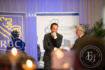 Sharing a laugh with a distinguished guest while Master of Ceremonies.