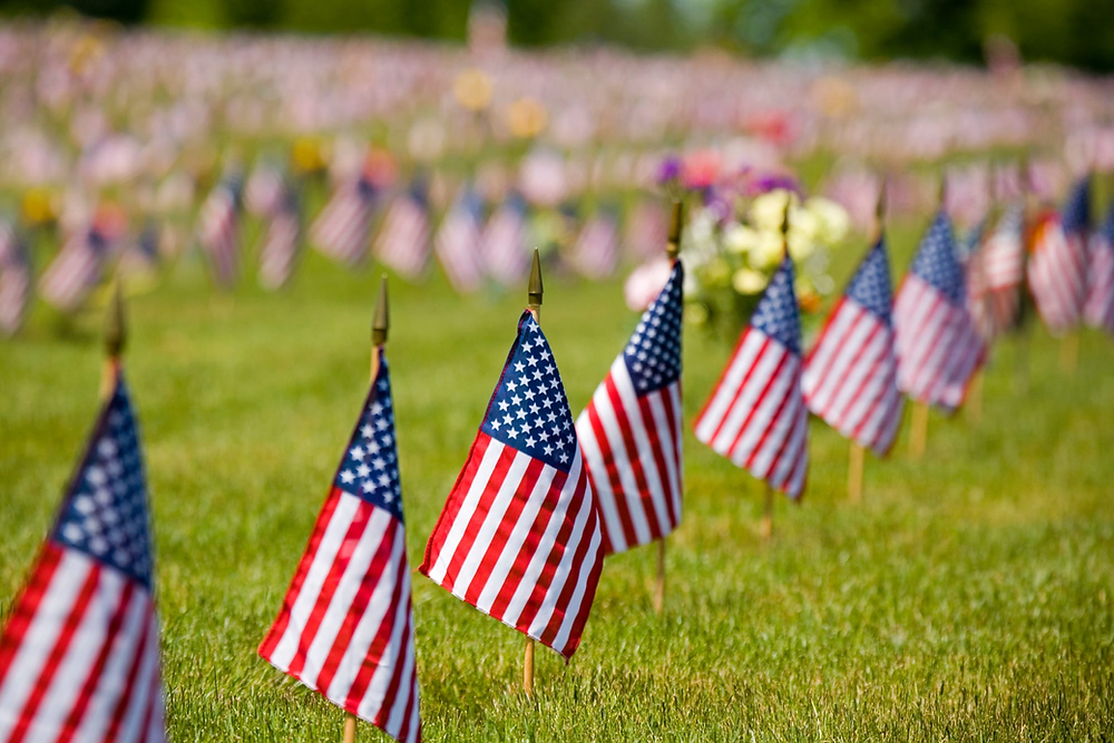 Row of American Flags Craig Tuttle/ Corbis