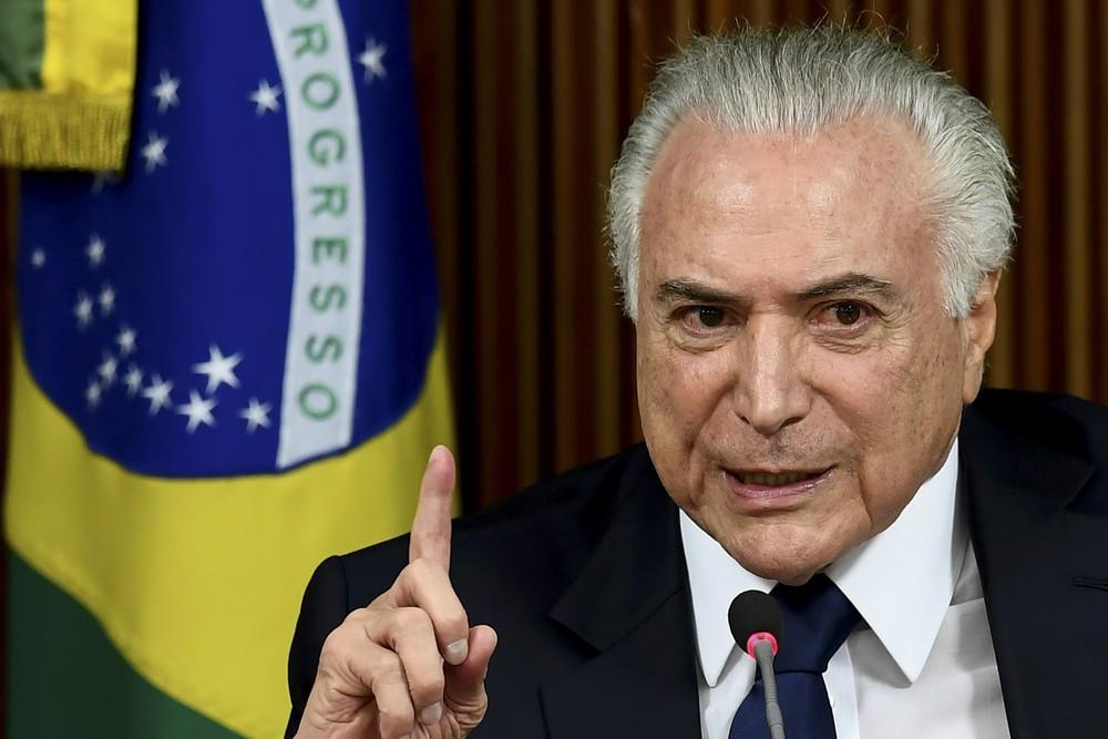 O presidente Michel Temer discursa durante reunião com prefeitos para discutir segurança pública, em Brasília (Foto: Evaristo Sa/AFP)