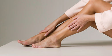 woman massaging feet