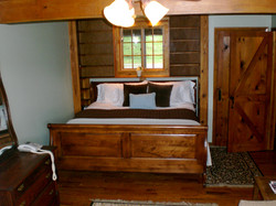 Master bedroom offers a king bed